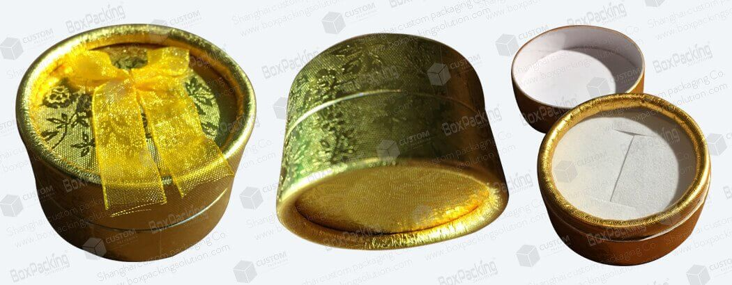 small round gold cardboard tubes