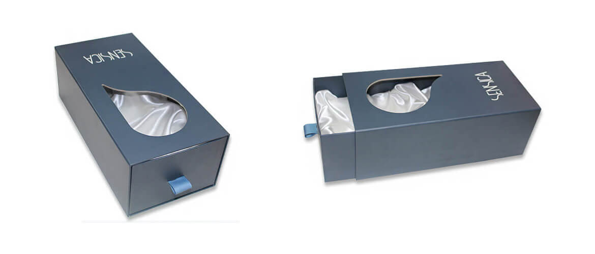 Drawer packaging with cut shape window and ribbon liner